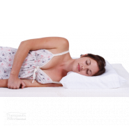 Tranquillow Contoured Pillow lady sleeping on her side in a nightie